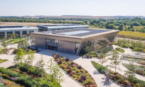 Aerial image of EMBL-EBI South building on campus