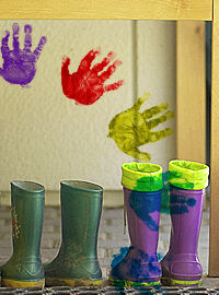 children's boots and hand prints on wall